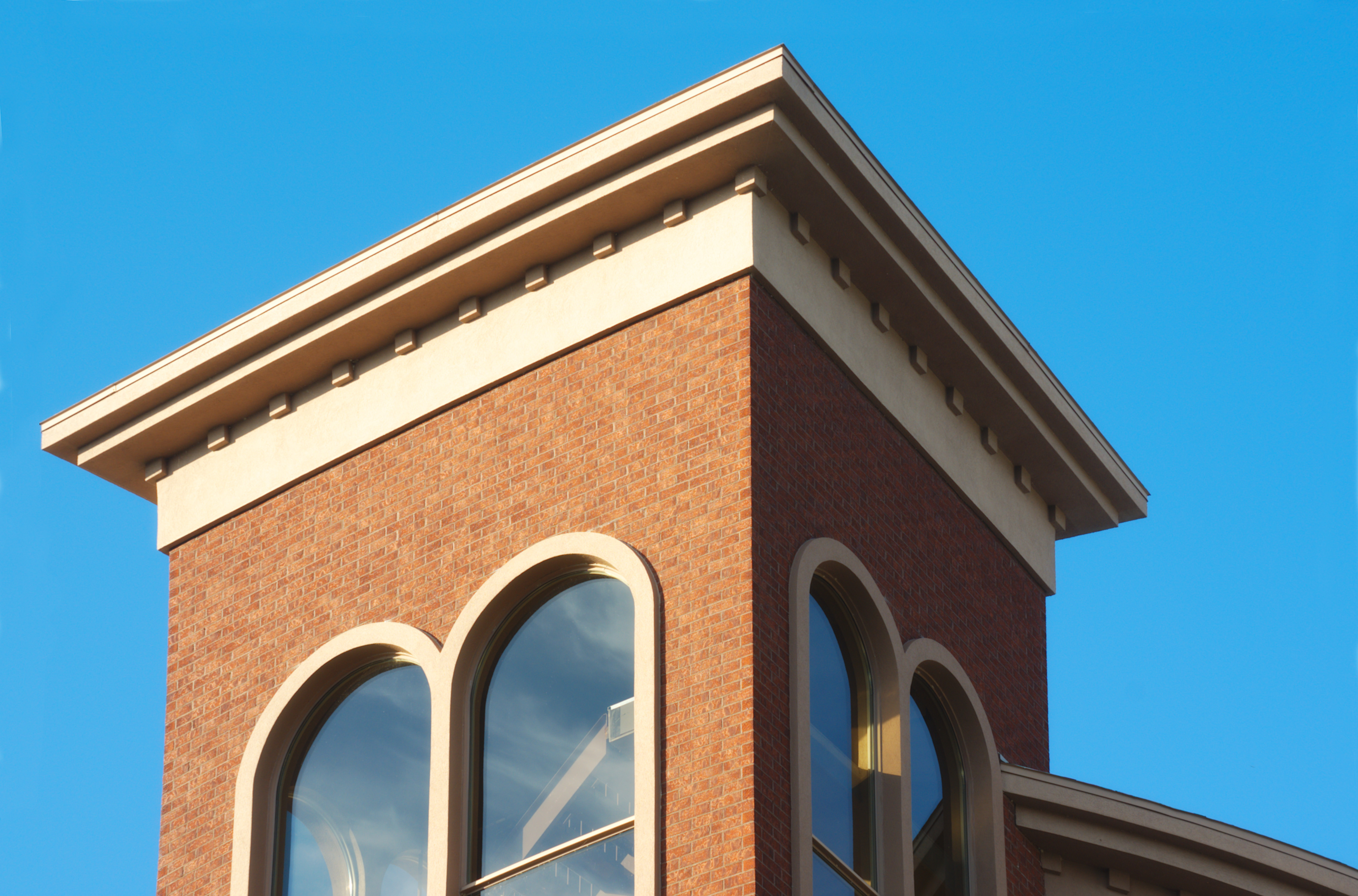 red brick building top on blue sky stair case
