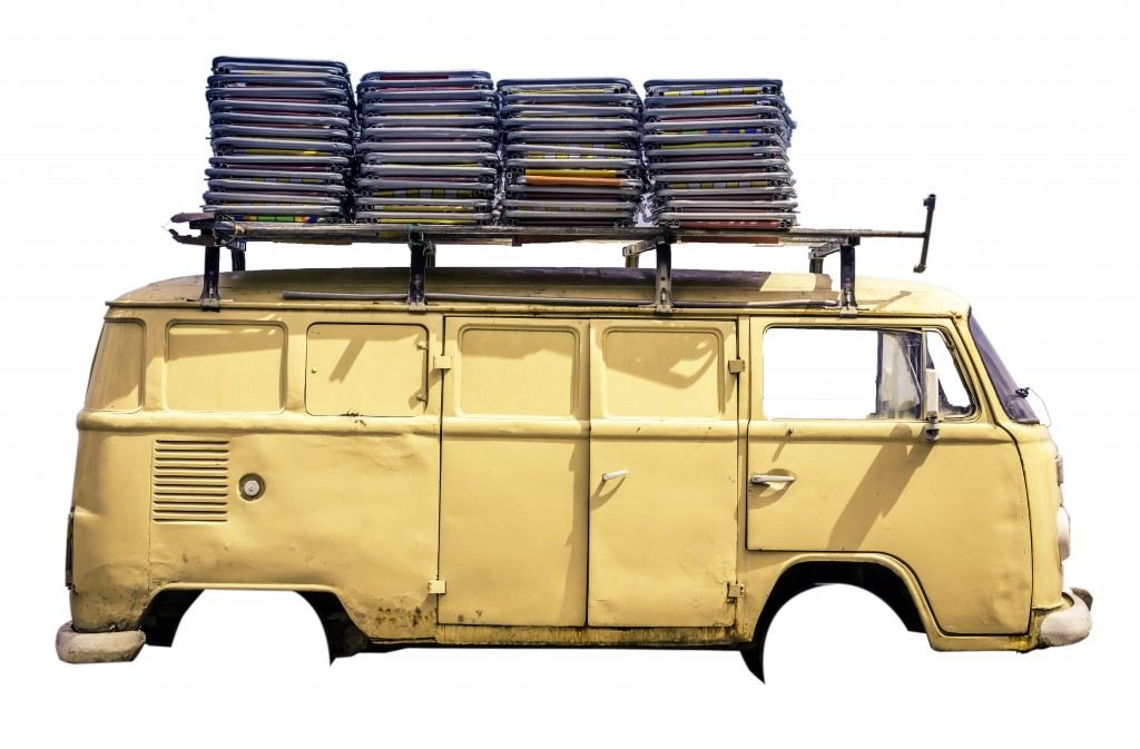 Vintage van in the beach of Ipanema with chairs on the roof